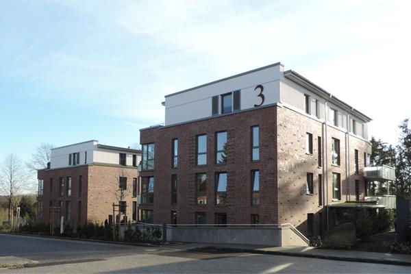 Öffentlich geförderter Wohnraum – 30 Prozent der Wohnungen in diesen Häusern sind vom Kreis gefördert und werden zu 5,60 Euro kalt vermietet